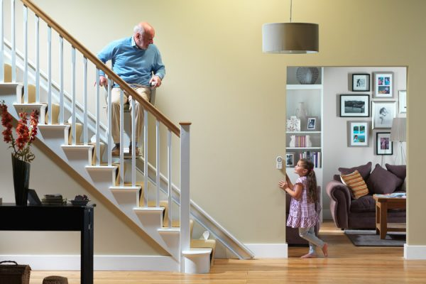child talking to man on residential stairlift image
