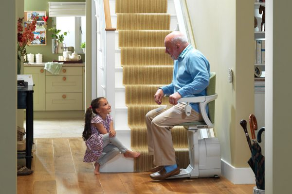 child talking to main on residential stairlift image