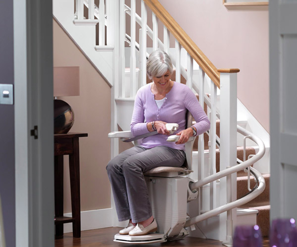 woman on residential stairlift image on Bedco Mobility website