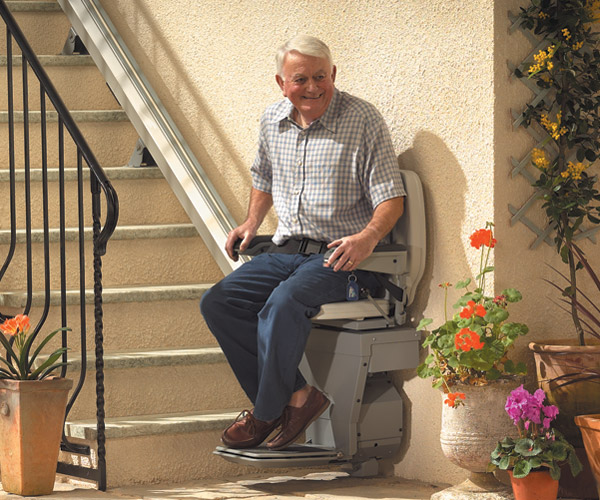 man on residential stairlift image on Bedco Mobility website
