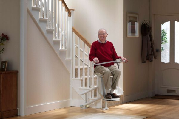 man on residential stair lift on Bedco Mobility website