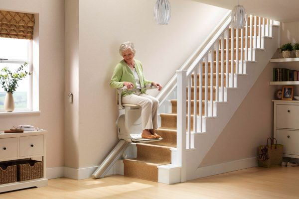woman on residential stairlift on Bedco Mobility website