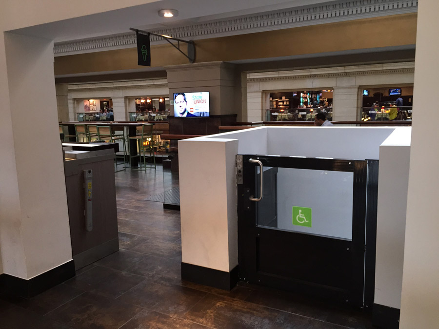 Shake Shack wheelchair lift upper gate image on Bedco Mobility