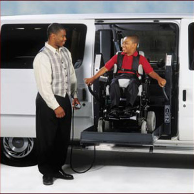 Man and child on Ricon Reliant accessible handicap wheelchair van image