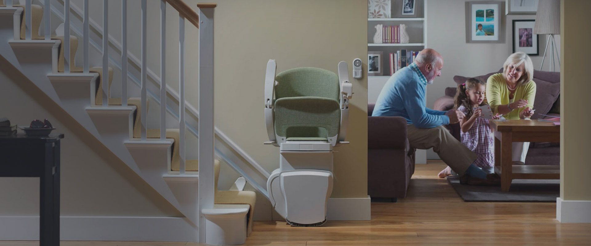 stock image of man, woman, child and stairlift