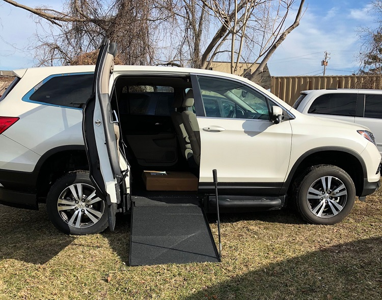 2018 Honda Pilot with wheelchair ramp deployed from side entry