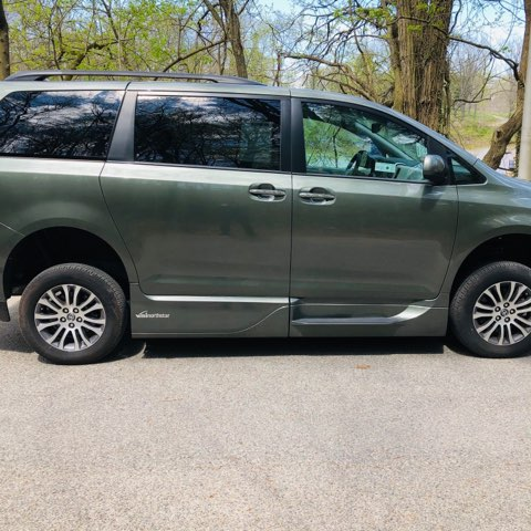 side view of green accessible van
