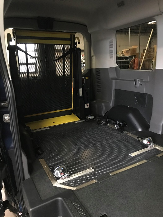 Interior of transit with wheelchair ramp and tie downs