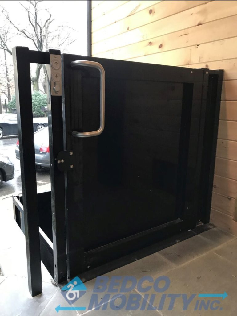 photo of upper gate of wheelchair lift on bedco website