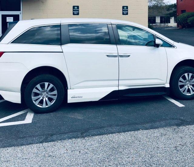 passenger side of white honda odyssey accessible minivan