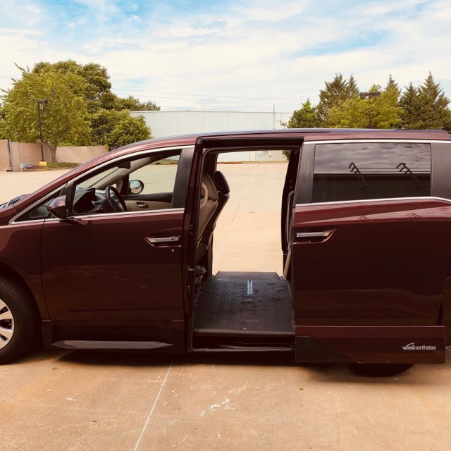 drivers side view of honda odyssey