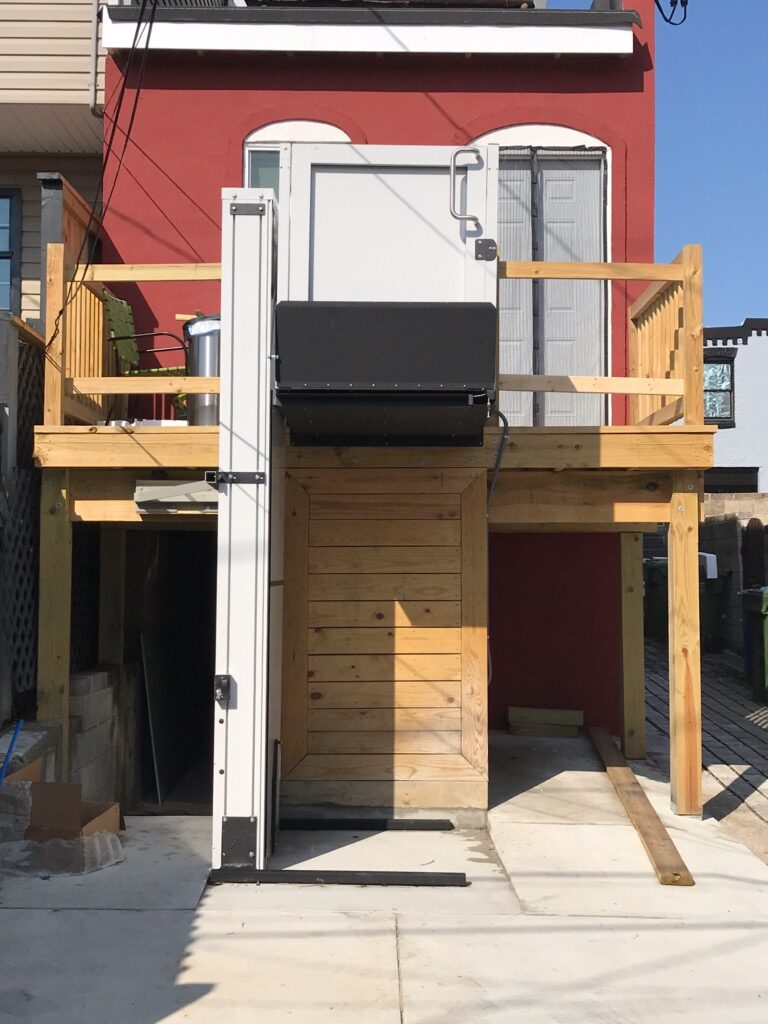 residential porch lift raised at top landing
